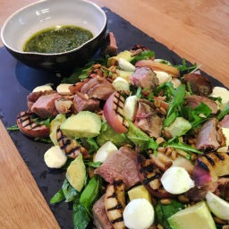 lamb with grilled peach, rocket, mozzarella, pinenut & almond salad with rockin mint pesto