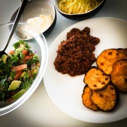 a take on nachos: chipotle mince, with kumara chips, avocado, tomato and coriander salsa