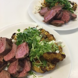 indian spiced roasted cauliflower served with lamb rump